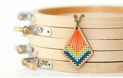 Embroidered wooden pendant